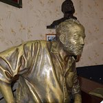 Statue of Ernest Hemingway at the bar.