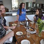 Guests enjoying shrimp'n'grits at 22 Square Restaurant