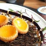 Freshly baked egg custard tarts.