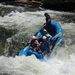 Chattooga River white water rafting with Wildwater. Going over Class IV Bull Sluice