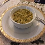 Rose water pudding topped with crushed pistachio