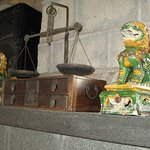 Old balance scales; the weights are kept in the drawers under. Guarded by two lions...