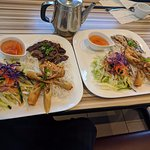 chicken, beef and spring rolls with vermicelli