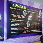 a selection of sundaes and more on the menu board
