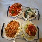 Szechuan king prawns £ 12.95; Pork filet in sweet & sour – Peking style - £ 9.25; Seasonal green