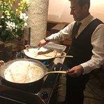 Staff preparing schnitzel in the dining area.