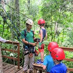 Getting hooked up for the last zipline, which is traveled backwards.