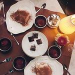 tiramisu and complimentary raspberry sorbet and chocolates