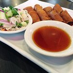 Sauces and garnishes really complemented the spring rolls.
