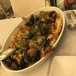 Various locally caught fish cooked with other seafood in a divine light broth