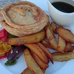 Vegan pie with gravy, veggies and chips