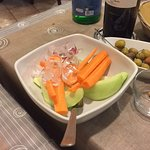 carrots, melon and radish served before the starter.