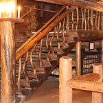 Stairs from 1st floor to 2nd in lobby of Old Faithful Inn. Tavern window at right.