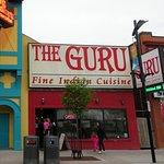 front of The Guru