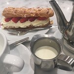 strawberry eclair and a pot of tea