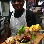 Siya, our griller, making burgers with love and passion