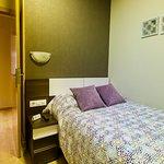 Habitación Triple con balcón (zona cama de matrimonio)