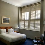 The high ceiling room with shutters on the windows. A very comfortable room.