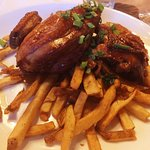 Roasted half chicken marinated in soy sauce with fresh cut fries