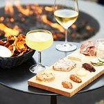 Charcuterie, snacks and drinks by the fire pit