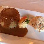 Steamed vanilla sponge pudding with maple walnut ice cream and caramel sauce