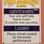 Playful sign inside the bathroom