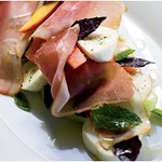 Salad of watermelom, mozzarella, prosciutto, oliv oil