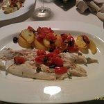 Branzino all'isolana, patate, pomodorini, olive e capperi