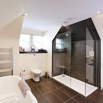 Large bathroom featuring roll-top bath and separate shower - Kings Apartment