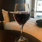 Glass of Napa red from happy hour. Third floor room.