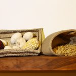 Decoration with purple corn and yellow corn and tunta blanca (White dried potatoes)
