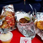 Our bounty (lobster roll, crabcake, scallops)