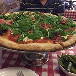 Good pizza with long chili pepper.