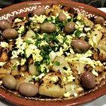 Bacalhau A Gomes de Sa - cod, onion, potato, black olives, parsley, & chopped egg.