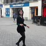 Young woman dancing on Quay Street, Galway, Ireland