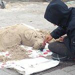 Street sand artist along Quay Street, Galway, Ireland