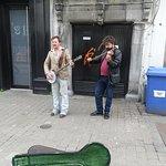 Street musicians along Quay Street, Galway, Ireland.