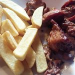 rabbit with garlic sauce and fries