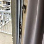"Rust on balcony door frame and flimsy ""lock"""