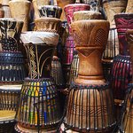 Drum collection as both decoration and performance instruments.