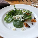 A split portion of the spinach salad