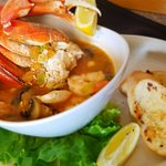 Surfrider Seafood Saute with half a crab, shrimp, clams... and more