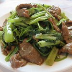 Stirred fry beef with morning glory in fermented salted shrimp paste