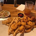 Friend shrimp with fries and slaw.