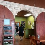 Dining room. Wait station and cashier behind the arch. Wine specials were very reasonable.