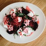 Salad from goat cheese and beetroot with foam