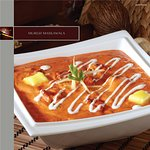 MURGH MASKAWALA - Chargrilled chicken simmered in a butter and cream speckled tomato gravy.