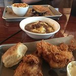 Fried Chicken, Mashed Potatoes and Smoked Brisket Gravy, Pulled Pork Biscuit in background