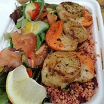 Seared scallops with beetroot couscous and salad