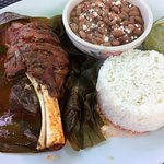 Lamb shank with rice, beans and guacamole